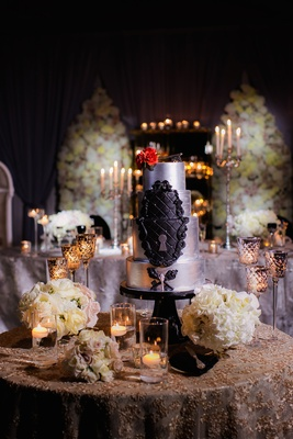 Wedding cake in silver with black tufted details, keyhole, antique key embellishments, red rose