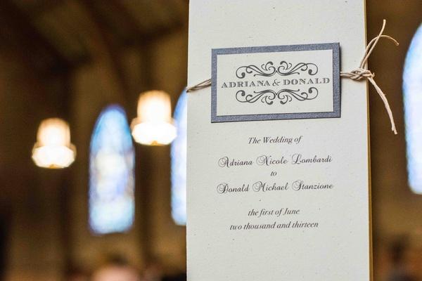 Elegant white ceremony program tied with twine