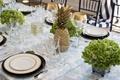 southern-inspired wedding, summer reception décor pineapple gold centerpiece green hydrangea