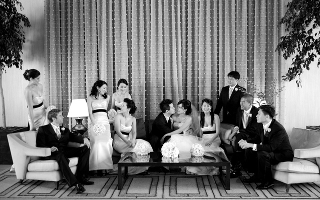 Black and white photo of bride and groom with wedding party at The Beverly Hilton