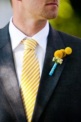 Groom in yellow stripe tie and yellow billy buttons boutonniere