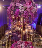 grand bold pink purple centerpiece feminine wedding styled shoot dinner candles roses gold