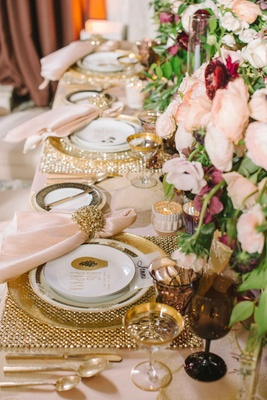 gold placemats, gold-rimmed glasses, gold napkin rings