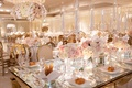 wedding reception mirror table top with crystal candelabra low centerpiece white pink rose orchid