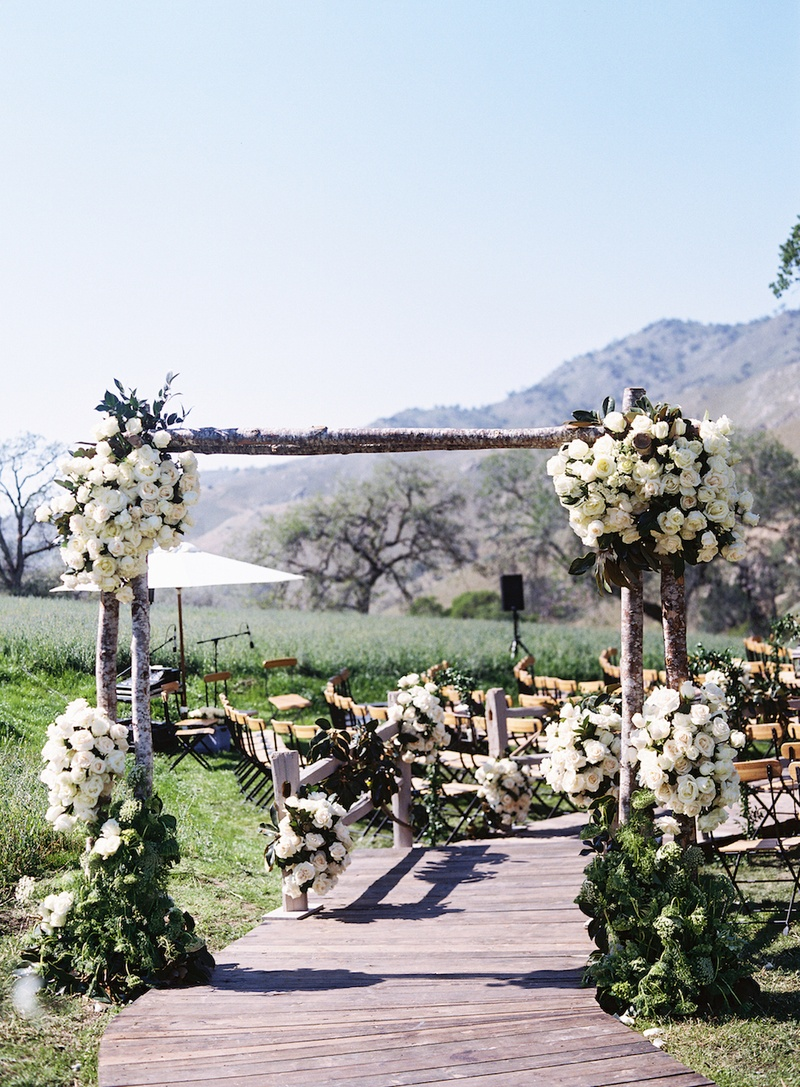 intimate wedding venues in orange county ca%0A     Rustic tree trunk arch over wood plank ceremony aisle    Wedding