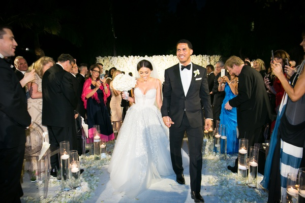 nighttime wedding ceremony recessional, bride in inbal dror wedding