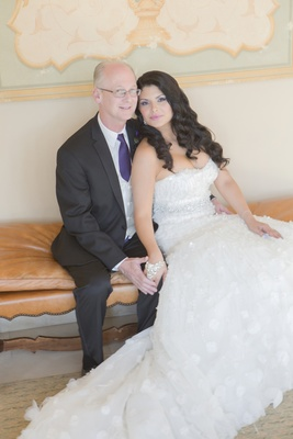Latin woman in wedding dress with man in tuxedo