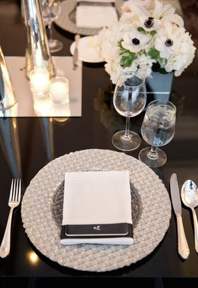 Silver braid charger plate topped with white napkin