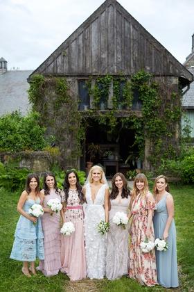 Bride in deep v-neck wedding dress marchesa with bridesmaids mismatched dresses blue pink floral