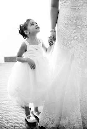 black and white photo of flower girl looking up at bride, joe panik and brittany pinto wedding