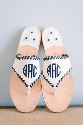 monogrammed sandals with black leather stitching