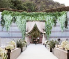 Skirball Cultural Center Jewish wedding ceremony outdoor greenery blush white flowers wisteria