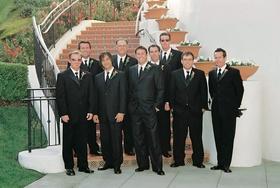 Groomsmen in tuxedos at Bacara steps