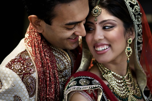 Indian bride and groom in lengha and sherwani