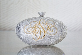 sparkling silver clutch with monogram in gold letters