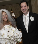 groom and bride after ceremony with bride's orchid bouquet