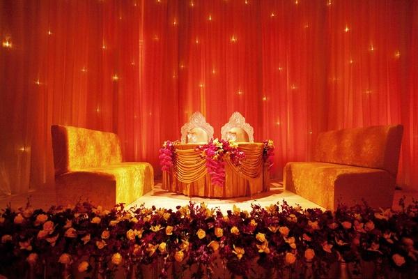 Golden velvet benches at Indian reception