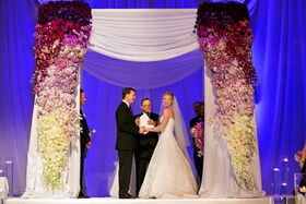 Morgan Pressel at wedding ceremony under chuppah