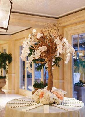 Floral-embellished Manzanita tree seating display