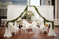 pre-ceremony lounge area for getting ready, white french furniture, white canopy, greenery garland