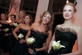 Bridesmaids in black party dresses with calla lily bouquets