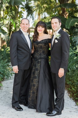groom black suit parents wedding attire black dress off the shoulder florida wedding classic