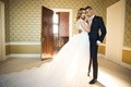 bride goom embracing ball gown suit ines di santo michael kors classic vintage looks styled shoot