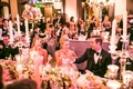 Guests toast champagne during reception with candelabra on table