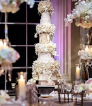 Tall wedding cake with lace details, sugar flower tiers, gold monogram Tracy Morgan wedding
