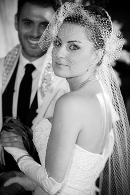 Black and white photo of bride with netted veil