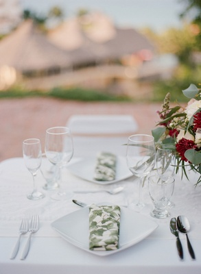 Wedding rehearsal dinner welcome party place setting white plate with foliage print napkin linen