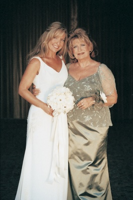 bride and mother pose together