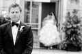 black and white photo of groom waiting for his bride for their first look before ceremony