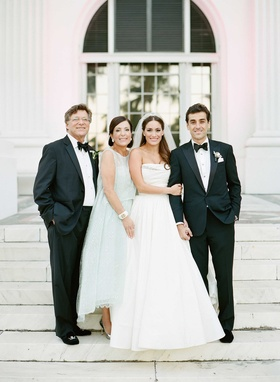 Light blue green pastel mother of bride Monique Lhuillier dress with father of bride in tuxedo