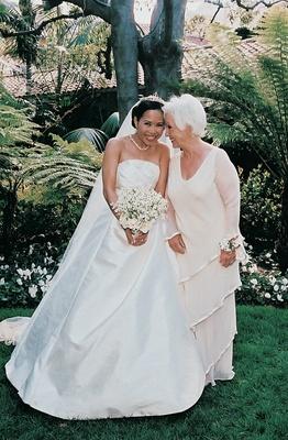 Bride with her mom in garden area of resort