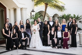 Bride in gown from Mark Ingram Atelier groom in tuxedo matron of honor and mother in romona keveza