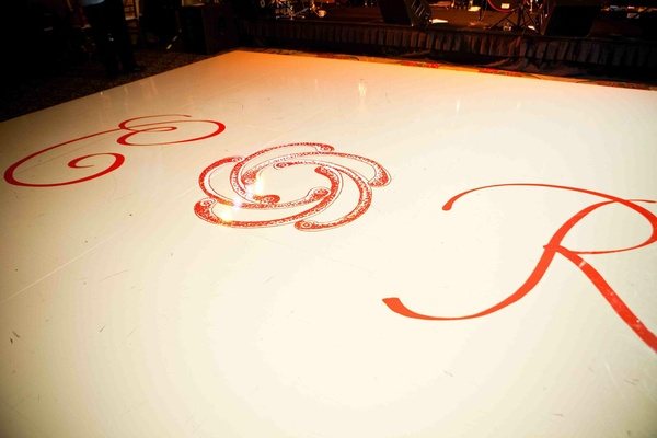 White and orange floor with monogram and motif