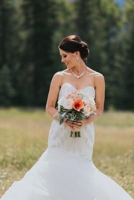 bride in watters mermaid wedding dress with beaded bodice, low updo