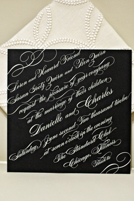 Wedding invite on black paper with white calligraphy