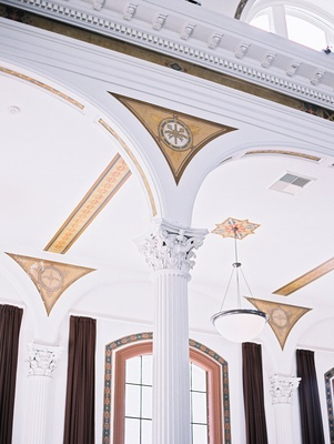 Vibiana's white interior with columns and frescoes