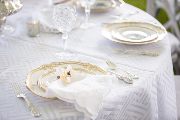 floral napkin ring with pearl detail at wedding place setting