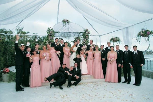 Portrait of guests under ceremony tent and chuppah