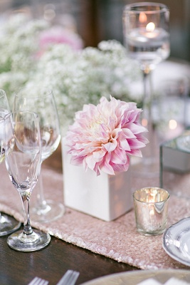 Wedding wood reception table with light pink sequined runner, light pink dahlia in white vase