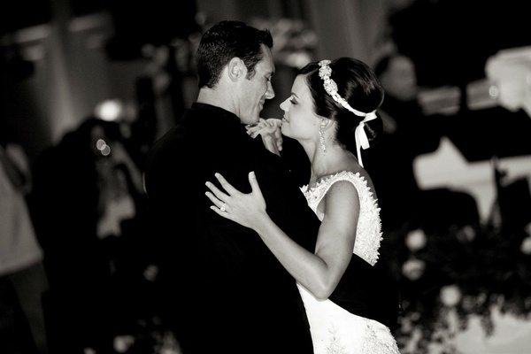 Black and white photo of newlyweds dancing