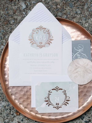 blue and white watercolor invitation suite on a rose gold serving platter