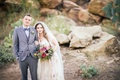 Groom in grey Hugo Boss three-piece suit with bride in a Claire Pettibone dress
