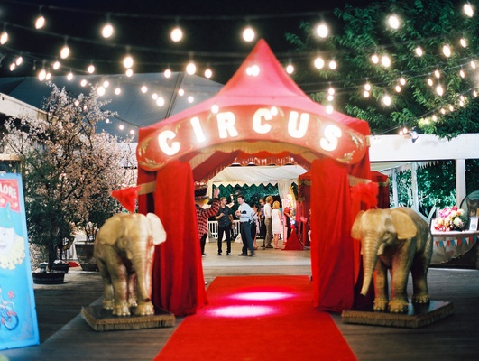 Red curtains circus marquee letters red tent gold elephant decor outdoor wedding cafe lights CJ