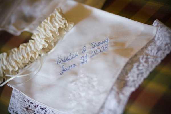 White garter with embroidered handkerchief