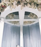White ceremony structure with white orchid and hydrangea flowers