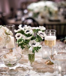Wedding reception decoration rose in glass bowl gold candlestick white anemone flowers